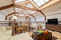 BNPS.co.uk (01202) 558833. <br /> Pic: Hamptons/BNPS<br /> <br /> The house has 3,455 sq ft of accommodation focused around the double height living room with a mezzanine floor <br /> <br /> A grand mews house that was home to Henry Tate's art collection before he gifted it to the Tate Gallery is on the market for £1.8m.<br /> <br /> Henry Tate Mews is part of the former mansion that belonged to the sugar merchant in the late 1800s for 25 years.<br /> <br /> What is now an impressive Grade II* listed double height reception room was his billiard room where he displayed famous Pre-Raphaelite works of art including John Everett Millais' Ophelia.<br /> <br /> The five-bedroom house, which is on the market with Hamptons, also has shared access to the beautiful six acres of gardens that include an orchard, folly and a listed grotto.