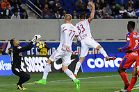 Harrison, NJ - Thursday March 01, 2018: Donis Escober, Aaron Long. The New York Red Bulls defeated C.D. Olimpia 2-0 (3-1 on aggregate) during a 2018 CONCACAF Champions League Round of 16 match at Red Bull Arena.