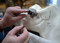 Justin Clark, owner of Red Arrow Taxidermy, uses clay Wednesday, Jan. 6, 2021, to form the structure around the eye of a deer while working on a mount for a customer in his shop in Hogeye. Visit nwaonline.com/210107Daily/ for today's photo gallery. <br /> (NWA Democrat-Gazette/Andy Shupe)
