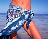 Sexy woman by the sea wearing a sarong..Bwejuu. Zanzibar. Tanzania..Model Released.