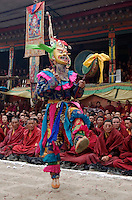 Masked dancer with skulls representing impermanence at the Cham dances, Katok Monastery - Kham, (Tibet), Sichuan, China