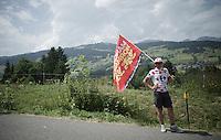 roadside flagged fan<br /> <br /> Stage 18 (ITT) - Sallanches › Megève (17km)<br /> 103rd Tour de France 2016