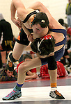 WOODBURY, CT, 12 FEBRUARY 2011-021211JW02-- Nonnewaug wrestler Brian Reilly Takes down Terryville Ben Russo for the win in the 135 weight class semi finals during the 2011 Berkshire League Championships at Nonnewaug High school.<br /> Jonathan Wilcox Republican-American