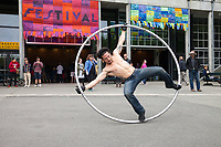 Cyr Wheel Street Performer, Northwest Folklife Festival 2015, Seattle Center, Washington, USA.