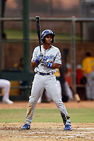 Melvin Santana #10 of the AZL Dodgers bats against the AZL Athletics at Phoenix Municipal Stadium on July 10, 2013 in Phoenix, Arizona. AZL Athletics defeated the AZL Dodgers, 7-1. (Larry Goren/Four Seam Images)