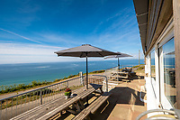 BNPS.co.uk (01202) 558833. <br /> Pic: ScottParryAssociates/BNPS<br /> <br /> Chefs and foodies will want to get their hands on this stunning clifftop home that comes with a popular fine dining restaurant attached.<br /> <br /> The View, a 50-cover restaurant and five-bedroom home with a rooftop terrace, is aptly named with its 180-degree panorama of Whitsand Bay in Cornwall.<br /> <br /> It is on the market for £1.5m with estate agents Scott Parry Associates who describe it as a 'world class seaside location' and the 'ultimate lifestyle opportunity.<br /> <br /> The house sits at the top of the 400ft high cliff, with a path down to the beach, popular with surfers, and its panoramic view takes in Rame Head, Eddystone Lighthouse, Looe Island and as far as The Lizard on a clear day.