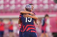 KASHIMA, JAPAN - AUGUST 5: Megan Rapinoe #15 of the United States celebrates scoring with Carli Lloyd #10 during a game between Australia and USWNT at Kashima Soccer Stadium on August 5, 2021 in Kashima, Japan.