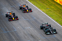 18th April 2021; Autodromo Enzo and Dino Ferrari, Imola, Italy; F1 Grand Prix of Emilia Romagna, Race Day;   44 HAMILTON Lewis gbr, Mercedes AMG F1 GP W12 E Performance, 11 PEREZ Sergio mex, Red Bull Racing Honda RB16B, 33 VERSTAPPEN Max nld, Red Bull Racing Honda RB16B on the early lap in wet conditions