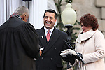 Nevada Gov. Brian Sandoval takes the oath of office from Chief Supreme Court Justice Michael Douglas during Monday's inauguration, Jan. 3, 2011 at the Capitol in Carson City, Nev. First Lady Kathleen Sandoval is at right. <br /> Photo by Cathleen Allison