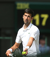 Novak Djokovic (SRB) during his match against Philipp Kohlschreiber (GER) in their Gentleman's Singles First Round match<br /> <br /> Photographer Rob Newell/CameraSport<br /> <br /> Wimbledon Lawn Tennis Championships - Day 1 - Monday 1st July 2019 -  All England Lawn Tennis and Croquet Club - Wimbledon - London - England<br /> <br /> World Copyright © 2019 CameraSport. All rights reserved. 43 Linden Ave. Countesthorpe. Leicester. England. LE8 5PG - Tel: +44 (0) 116 277 4147 - admin@camerasport.com - www.camerasport.com