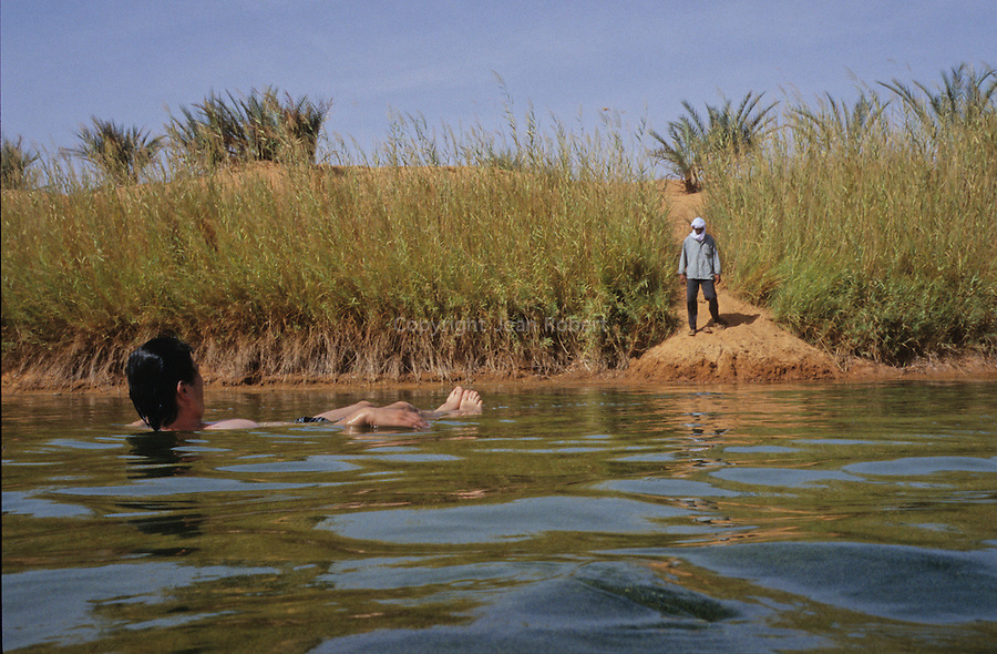Sun is setting and we float like a cork in the waters of the lake Oum El Ma. Rare moments in the heart of Sahara!