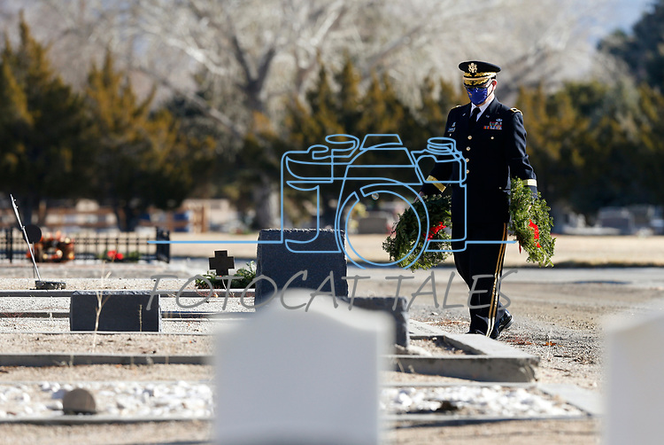 Nevada National Guard Brigadier General Michael Hanifan participates in the National Wreaths Across America Day, as volunteers place wreaths on the graves of veterans at the Lone Mountain Cemetery, in Carson City, Nev., on Saturday, Dec. 19, 2020. The program honors veterans at more than 2100 cemeteries around the world. <br /> Photo by Cathleen Allison/Nevada Momentum Fueled by RAD