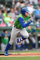 Third baseman Emmanuel Rivera (7) of the Lexington Legends runs out a grounder in a game against the Greenville Drive on Friday, June 30, 2017, at Fluor Field at the West End in Greenville, South Carolina. Lexington won, 17-7. (Tom Priddy/Four Seam Images)