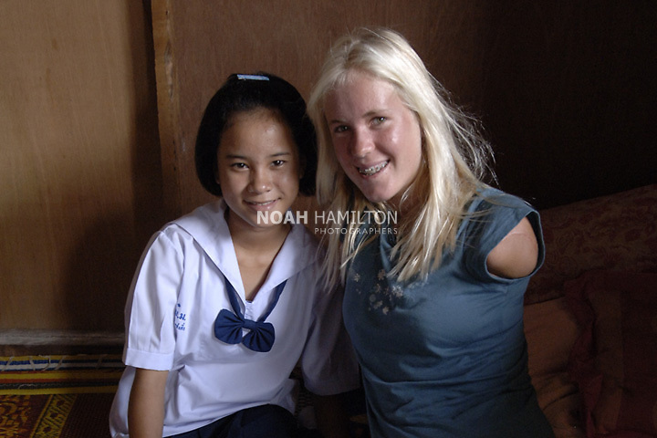 SEASURGE04 or TSUNAMIRECOVERY ..At the World Vision transitional housing center in Ban Nai Rai, Bethany Hamilton talked with 13 yr-old Ketsara Sae-Sia (Sin???) who lost her mother and home to the tsunami, comparing the lessons they learned on how to handle tragedy and loss. ..In cooperation with World Vision, surfing champion Bethany Hamilton, 16, traveled to tsunami affected communities in Thailand. On the beach at Phuket she gave surfing lessons to children from a sea gypsy village. Then she toured World Vision projects which she supports. Please refer to Scribe stories written by Cecil Laguardia...Please continue to monitor new updates on the disaster, from all areas, in the NewsVision database as well as the Asia Tsunami Response 2004 database. ..Used in Spring 2006 World Vision Magazine - pg. 10..Asia ..digital ..color ..vertical
