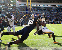 WVU wide receiver Tavon Austin pulls in a 12-yard touchdown catch while being defended by Pitt defensive back Ricky Gary (26). The WVU Mountaineers defeated the Pitt Panthers 35-10 at Heinz Field, Pittsburgh, Pennsylvania on November 26, 2010.