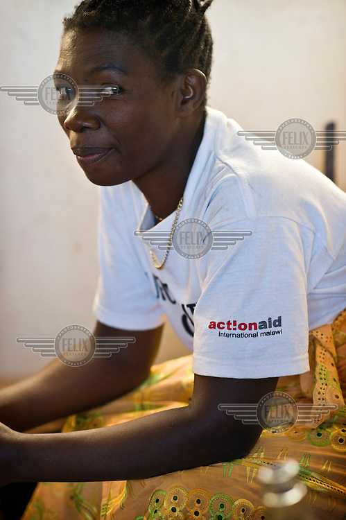 Alinafe Nkhoma, member of the women's group Chigwirizano, wears an ActionAid t-shirt at a meeting with representatives of ActionAid, who, along with local women's group Chigwirizano, constructed a three kilometre long water pipeline providing clean water to Ntalava village and the surrounding area.