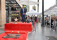 LOS ANGELES, CA. February 21, 2020: Ronnie Dunn & Dr. Phil McGraw at the Hollywood Walk of Fame Star Ceremony honoring Dr Phil McGraw.<br /> Pictures: Paul Smith/Featureflash