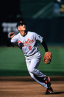 OAKLAND, CA - Cal Ripken of the Baltimore Orioles chases a foul ball during a game against the Oakland Athletics at the Oakland Coliseum in Oakland, California on April 23, 2000. Photo by Brad Mangin