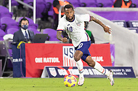 ORLANDO CITY, FL - JANUARY 31: Kellyn Acosta #10 of the United States moves with the ball during a game between Trinidad and Tobago and USMNT at Exploria stadium on January 31, 2021 in Orlando City, Florida.