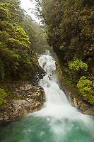 Scenic landscape with view of the Christie Falls waterfall on the road to the Milford Sound in Fiordland National Park, South Island, New Zealand