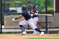 New York Yankees Jasson Dominguez (25) hits a triple during an Extended Spring Training game against the Philadelphia Phillies on June 22, 2021 at the Carpenter Complex in Clearwater, Florida.  (Mike Janes/Four Seam Images)