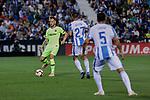 CD Leganes's Oscar Rodriguez (L) and Jonathan Cristian Silva (R) and FC Barcelona's Ivan Rakitic during La Liga match between CD Leganes and FC Barcelona at Butarque Stadium in Madrid, Spain. September 26, 2018. (ALTERPHOTOS/A. Perez Meca)