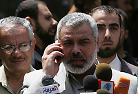 """Palestinian Hamas prime minister Ismail Haniyeh holds glasses of Yasser Arafat while visiting the house of late Palestinian leader Yasser Arafat in Gaza City, Gaza Strip, 30 June 2007. """"photo by fady Adwan"""""""