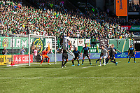 Portland, Oregon - Sunday October 6, 2019: Bill Tuiloma #25 heads the ball during a regular season match between Portland Timbers and San Jose Earthquakes at Providence Park in Portland, Oregon.