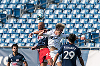 FOXBOROUGH, MA - JULY 25: USL League One (United Soccer League) match. Tiago Mendonca #33 of New England Revolution II battles for head ball during a game between Union Omaha and New England Revolution II at Gillette Stadium on July 25, 2020 in Foxborough, Massachusetts.