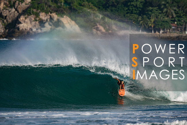 US big wave surfer World Champion Keala Kennelly rides a wave at Puerto Escondido's Zicatela Beach in Mexico. Photo by Victor Fraile / Power Sport Images