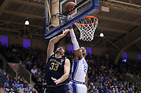 DUKE, NC - FEBRUARY 15: John Mooney #33 of the University of Notre Dame shoots off of the glass to avoid a block by Javin DeLaurier #12 of Duke University during a game between Notre Dame and Duke at Cameron Indoor Stadium on February 15, 2020 in Duke, North Carolina.