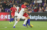 ORLANDO, FL - NOVEMBER 15: Scott Arfield #8 of Canada and Sebastian Lletget #17 of the United States battle for a ball during a game between Canada and USMNT at Exploria Stadium on November 15, 2019 in Orlando, Florida.