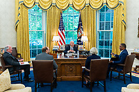 President Joe Biden meets with staff in the Oval Office of the White House, Friday, July 2, 2021, to prepare for remarks he will give celebrating the 2020 Baseball World Series Champions, the Los Angeles Dodgers. (Official White House Photo by Adam Schultz)