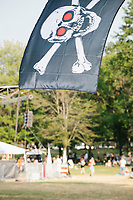 A Jolly Roger pirate flag hangs above the field in the protest area in FDR Park outside of the secure area surrounding the Democratic National Convention at the Wells Fargo Center in Philadelphia, Pennsylvania, on Wed., July 27, 2016.