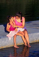 Mother and daughter share quality time on a lake dock, Pilgrim Lake, Cape Cod
