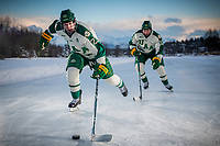 UAA Seawolves Hockey #23 forward Eric Sinclair and #10 forward Tanner Schachle on the ice at Anchorage's Westchester Lagoon.