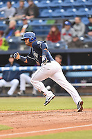 Asheville Tourists catcher Hamlet Marte (14) runs to first during a game against the Kannapolis Intimidators at McCormick Field on May 19, 2016 in Asheville, North Carolina. The Intimidators defeated the Tourists 10-7. (Tony Farlow/Four Seam Images)