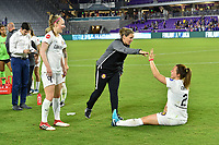 Orlando, FL - Saturday March 24, 2018: Utah Royals head coach Laura Harvey gives a high-five to Utah Royals defender Rachel Corsie (2) while Utah Royals defender Becky Sauerbrunn (4) watches after a regular season National Women's Soccer League (NWSL) match between the Orlando Pride and the Utah Royals FC at Orlando City Stadium. The game ended in a 1-1 draw.