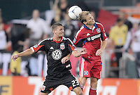 Chicago Fire forward Chris Rolfe (18) heads the ball against D.C. United midfielder Perry Kitchen (23) D.C. United defeated The Chicago Fire 4-2 at RFK Stadium, Wednesday August 22, 2012.