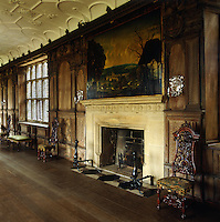The stone fireplace in the Long Gallery is surrounded by carved wood panelling
