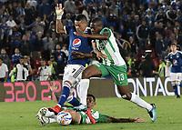 BOGOTA - COLOMBIA, 31-01-2018: Ayron del Valle (Izq) jugador de Millonarios disputa el balón con Helibelton Palacios (Der) jugador de Atletico Nacional durante partido por la final ida de la SuperLiga Aguila 2018 jugado en el estadio Nemesio Camacho El Campin de la ciudad de Bogotá. / Ayron del Valle (L) player of Millonarios fights for the ball with Helibelton Palacios (R) player of Atletico Nacional during the first leg match for the final of the SuperLiga Aguila 2018 played at the Nemesio Camacho El Campin Stadium in Bogota city. Photo: VizzorImage / Gabriel Aponte / Staff.