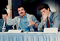 1987 FILE PHOTO - ARCHIVES -<br /> <br /> TV sex symbol Tom Selleck, flanked by Steve Guttenberg (left) and Ted Danson (right) mugs for reporters at a news conference to hype their film, 3 Men And A Baby. The film is about three swinging bachelors who suddenly must learn to cope with a 6-month-old baby girl. It is directed by Leonard Nimoy and is shooting in Kleinburg.<br /> <br /> 1987<br /> <br /> PHOTO :  Erin Comb - Toronto Star Archives - AQP