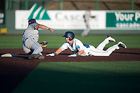 Everett AquaSox Bobby Honeyman (3) tries to avoid being tagged by Dust Devils second baseman Luke Becker (10) as he slides into second base during a Northwest League game against the Tri-City Dust Devils at Everett Memorial Stadium on September 3, 2018 in Everett, Washington. The Everett AquaSox defeated the Tri-City Dust Devils by a score of 8-3. (Zachary Lucy/Four Seam Images)