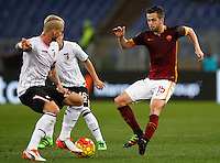 Calcio, Serie A:  Roma vs Palermo. Roma, stadio Olimpico, 21 febbraio 2016. <br /> Roma's Miralem Pjanic, right, is challenged by Palermo's Aljaz Struna during the Italian Serie A football match between Roma and Palermo at Rome's Olympic stadium, 21 February 2016.<br /> UPDATE IMAGES PRESS/Riccardo De Luca