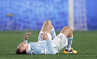 Calcio, semifinale di ritorno di Coppa Italia: Lazio vs Juventus. Roma, stadio Olimpico, 29 gennaio 2013..Lazio defender Stefan Radu, of Romania, lies on the pitch after beig injured during the Italy Cup football semifinal return leg match between Lazio and Juventus at Rome's Olympic stadium, 29 January 2013..UPDATE IMAGES PRESS/Riccardo De Luca
