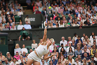 6th July 2021, Wimbledon, SW London, England; 2021 Wimbledon Championships, day 8;  Ashleigh Barty of Australia serves during the womens quarterfinal match
