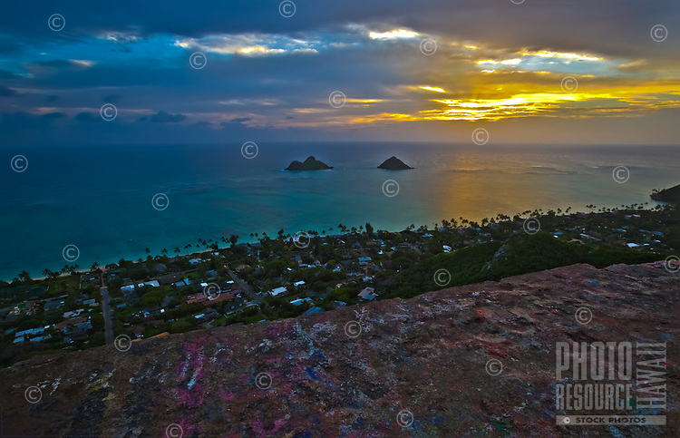 Sunrise over the Mokulua Islands or Islets and the Lanikai community in Kailua, Windward O'ahu, as seen from the Lanikai Pillboxes (or Ka'iwa Ridge Trail, or Pillbox Hike).