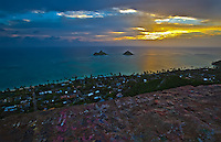 Sunrise over the Mokulua Islands or Islets and the Lanikai community in Kailua, Windward O'ahu, as seen from the Lanikai Pillboxes (or Ka'iwa Ridge Trail, or Pillbox Hike).