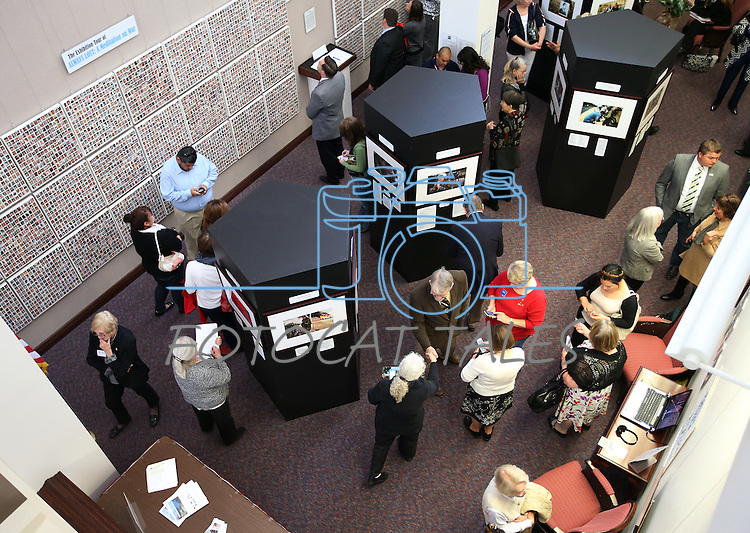 Visitors look at the Always Lost: A Meditation on War exhibit at the Legislative Building in Carson City, Nev., on Monday, April 6, 2015. <br /> Photo by Cathleen Allison/Nevada Photo Source