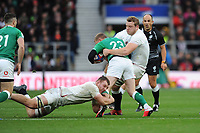 Keith Earls of Ireland is tackled by Sam Underhill and Joe Launchbury of England during the Guinness Six Nations match between England and Ireland at Twickenham Stadium on Sunday 23rd February 2020 (Photo by Rob Munro/Stewart Communications)